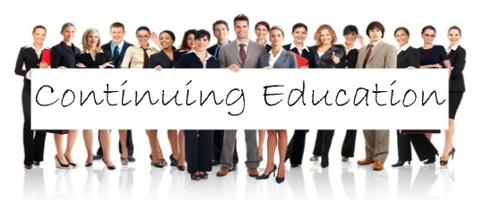 People holding Continuing Education Sign